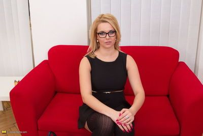Clothed blonde in glasses- skirt and stockings get stripped of her clothing