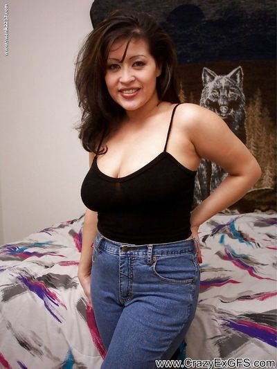 Sassy latina MILF with massive jugs undressing and teasing her slit