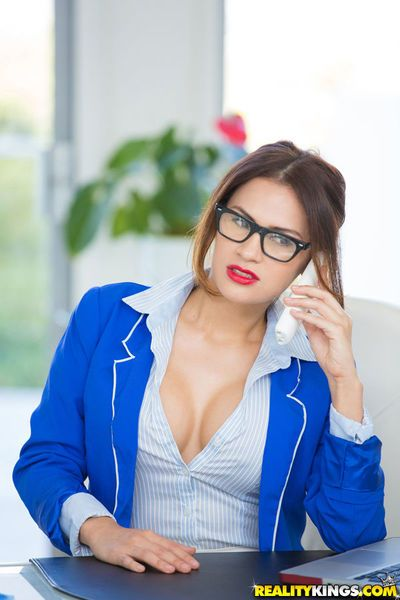 Latina babe in glasses Vanessa Cruz undresses to expose large breasts