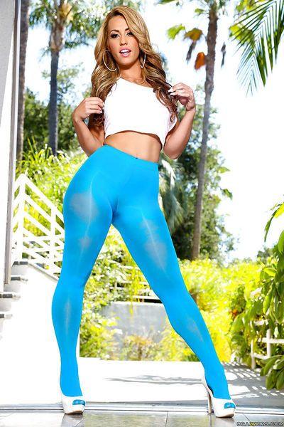 Blonde Latina babe Kelsi Monroe poses big sexy butt in hot blue pantyhose