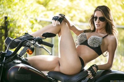 Sexy biker babe Kortney Kane gets rid of her snazzy lingerie outdoor