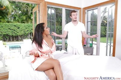 Buxom Euro chick Priya Price having her large breasts oiled and massaged