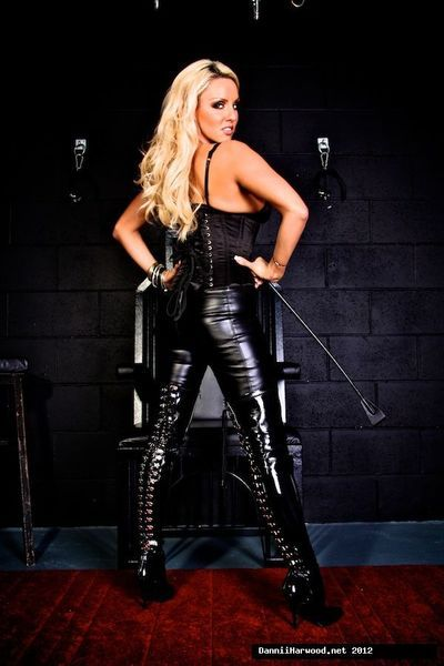 Dannii Harwood is posing in her high heels and latex outfit