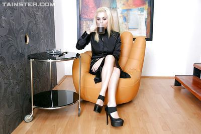 Fully clothed blondie has some messy fun with a fake cock and fake jizz