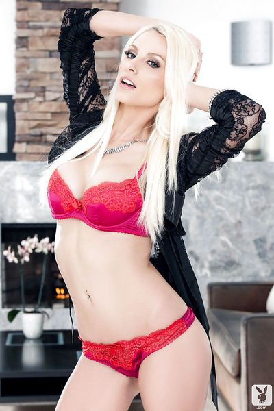 Immensely sexy blonde centerfold with shaved slit taking off her lingerie