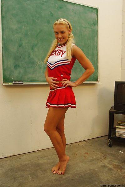 Nasty cheerleader Jamey James stripping and exposing her bare feet