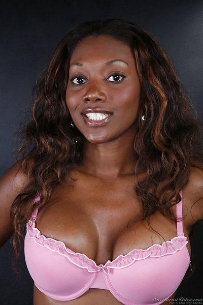 Seductive ebony chick Nyomi Banxxx slipping off her pink lingerie