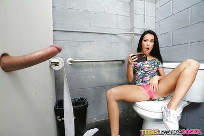 Teen pornstar Megan Rain sucking huge dick at gloryhole in restroom