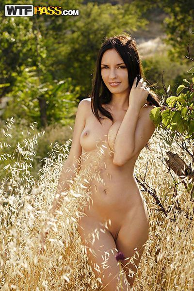 Adorable brunette babe with long sexy legs posing naked outdoor