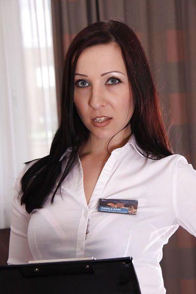 Euro babe and pornstar Ashley Dark looking sultry in maid uniform