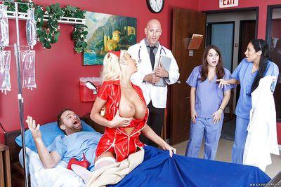 Nurse uniform suits this bosomy blonde Courtney Taylor in a best way