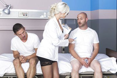 Horny blonde nurse Gigi is measuring that cock with her mouth