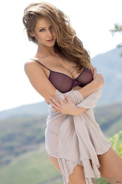 High heel wearing babe Emily Addison unveiling nice melons outdoors