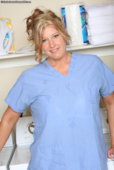 Chubby mature nurse with big saggy jugs undressing and spreading her cunt