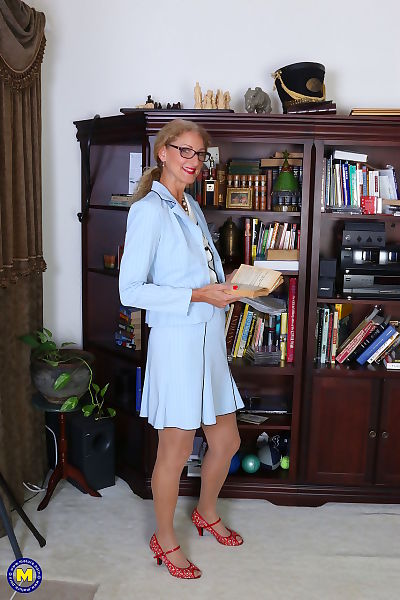 Classy mature granny strips off her suit to toy her pussy in the library