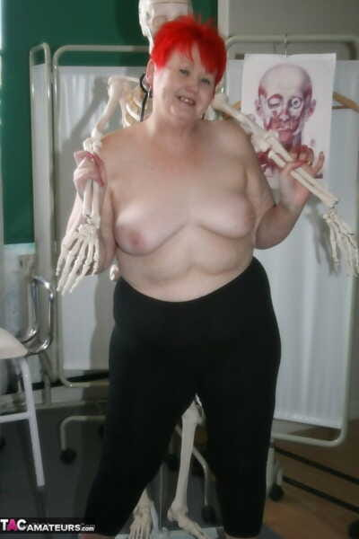 Slutty mature nurse in white stockings gets toyed up by a skeleton