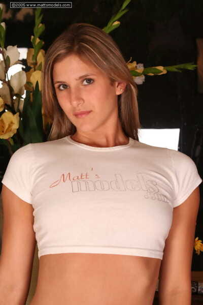 First timer Renee M releases her natural tits from cropped T-shirt