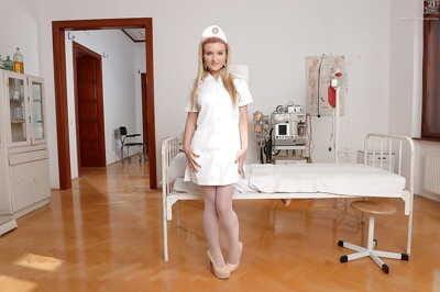 Euro babe Jemma Valentine posing in sexy nurse uniform and stockings