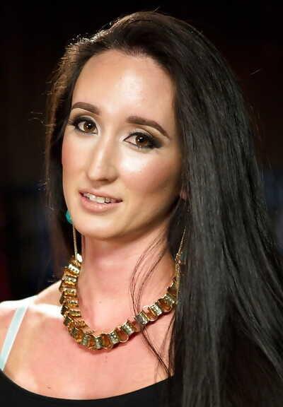 Brunette fetish model Virginia Tunnels bent over for forced pissing