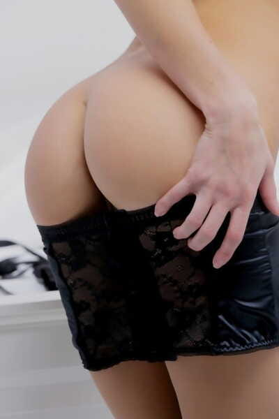 Erotic young beauty in cuffs & black lingerie licks huge cock like a lollipop