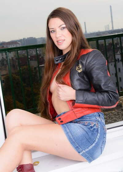 Girl next door Tiffany Doll rides a big dildo in wine colored Docs