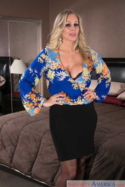 Blonde mature Julia Ann goes topless in black lacy lingerie in her bedroom