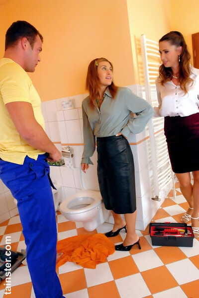 Fully dressed bisexual females partake in golden showers with a man