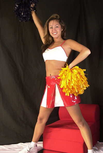 Amateur Latina chick Mailia releasing tiny breasts from cheerleader outfit
