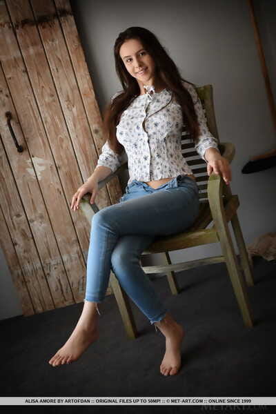 Sweet brunette teen Alisa Amore removes blue jeans on way to modeling naked