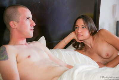 White girl Amber Rayne hops into bed for a threesome with her guy friends