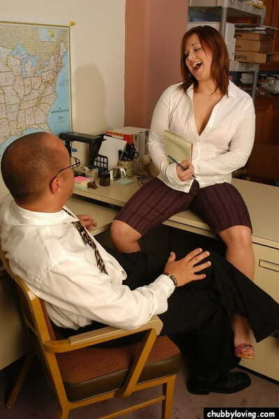 Redhead plumper with big saggy boobs giving big cock blowjob in office