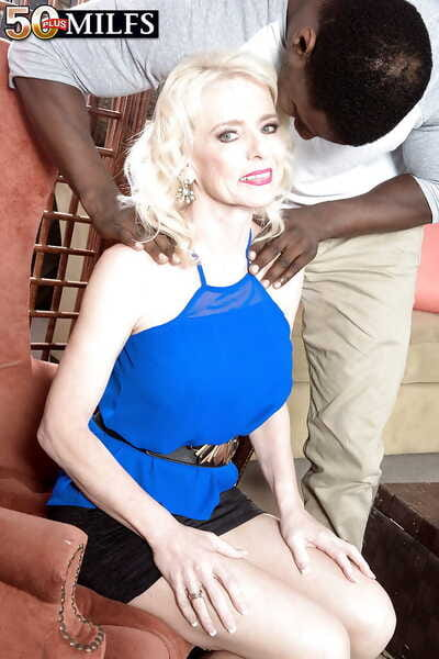 Older blonde wife Cammille Austin sporting anal creampie after interracial sex