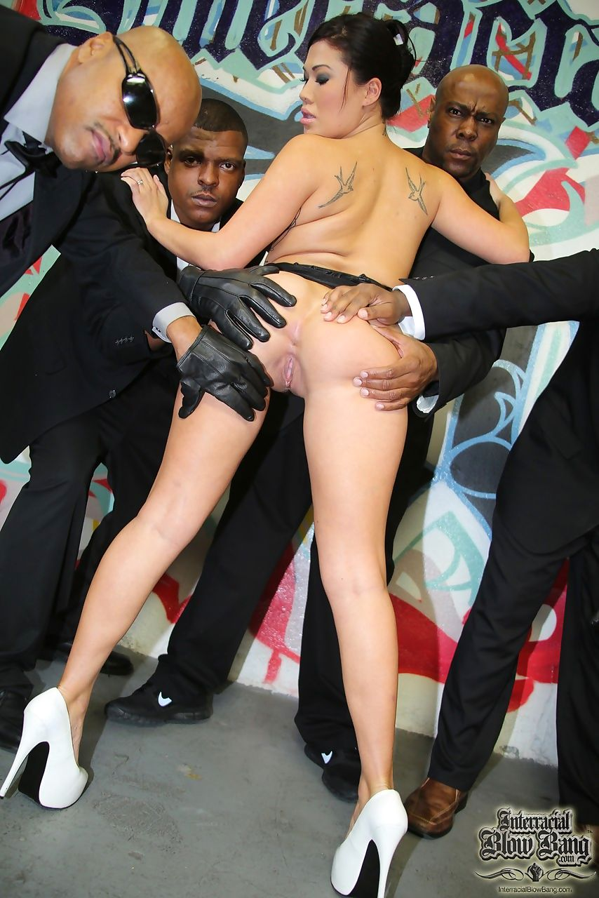 Hot Asian chick London Keyes sucks off a group of black men at once