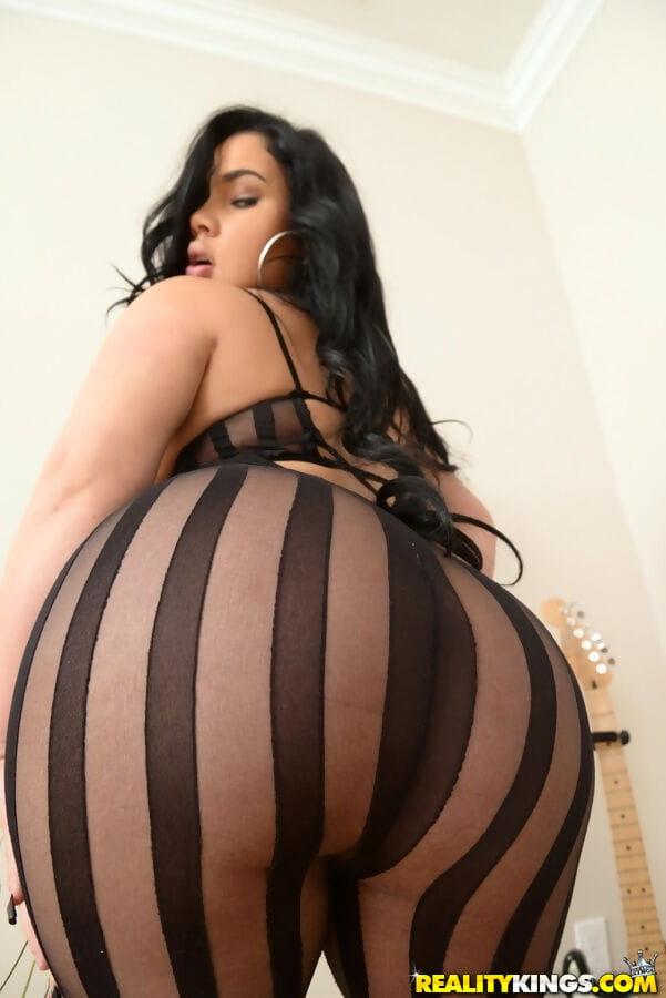 Latina MILF twerks her big bottom in sexy bodystocking to seduce a large cock