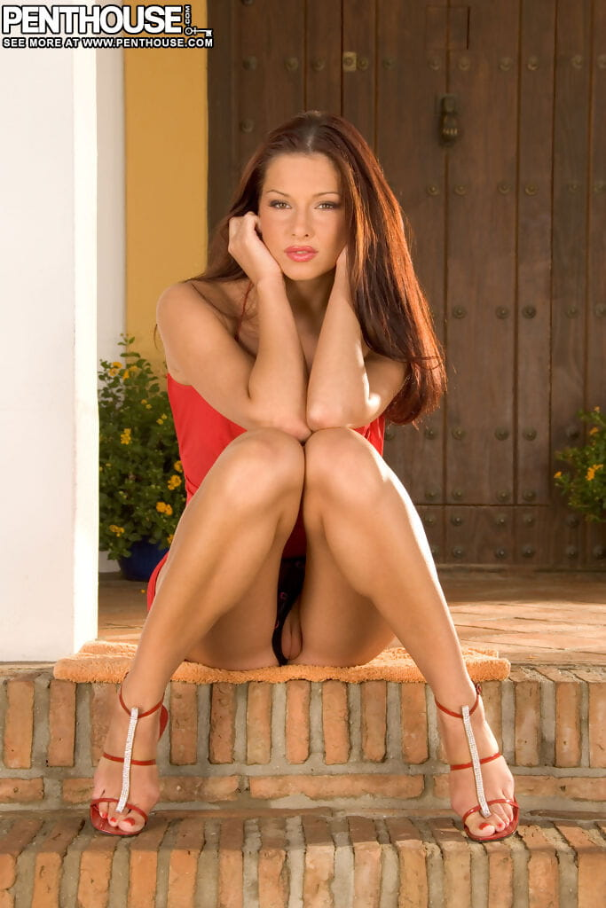 Beautiful female Evelyn Lory disrobes on back steps for a centerfold shoot