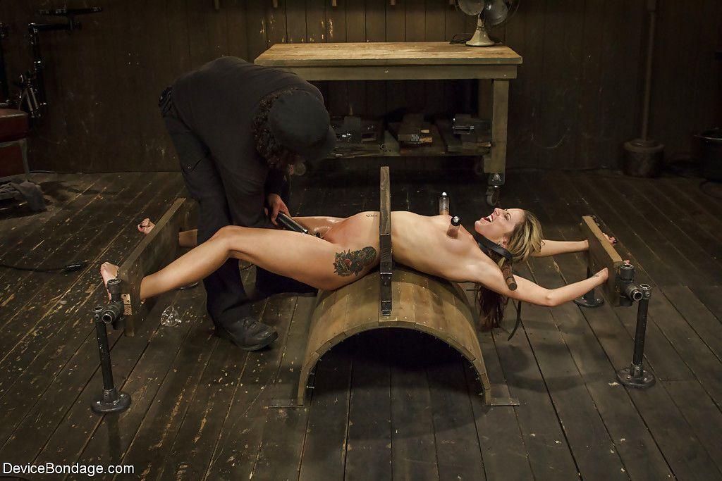 Skinny blonde fetish model Dallas Blaze stretched on rack for cunt flogging