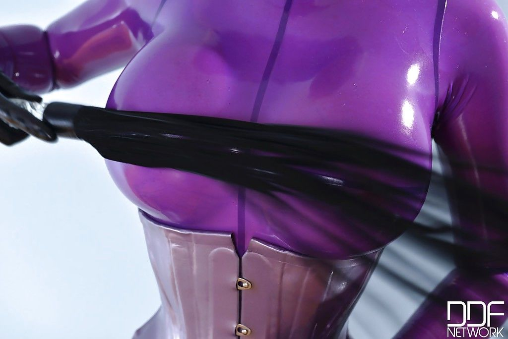 Pretty blonde babe Latex Lucy masturbating that pussy deep with a toy