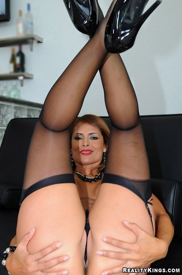 Serious milf in stockings and on high heels turns into a slut