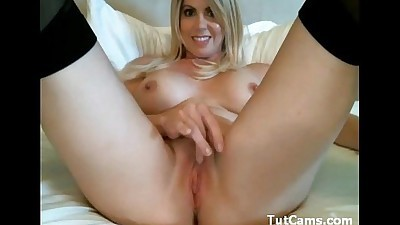 Amazing busty MILF toyingring-bed..