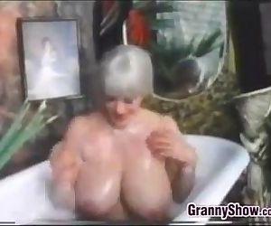 Busty Grandma In The Bath Tub..
