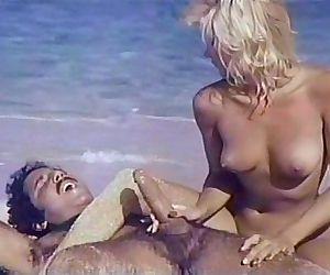 Ginger Lynn, Ron JeremySurf, sand..