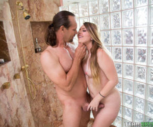 Chubby blonde teenager Cali Hayes giving a blowjob on her..