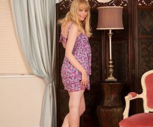 Naughty blonde amateur undressing and teasing her shaggy..