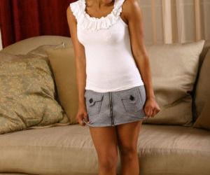 Ebony teen Sandy takes part in an amateur posing scene..