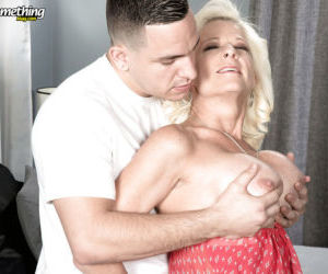 Blonde cougar Madison Paige displaying pierced cunt before..