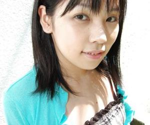 Asian teen Minami Ozaki getting naked and exposing her..