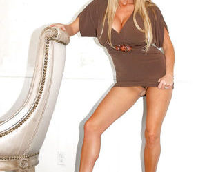Kelly Madison loves masturbating in her high heels and skirt