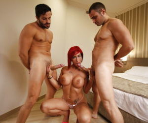 Big-boobed tattooed redhead Suhaila Hard and two hard dicks