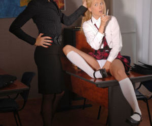 Dyke teacher in glasses coerces young blonde into lezdom..