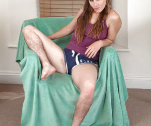 Hirsute broad with small tits showing off hairy legs..